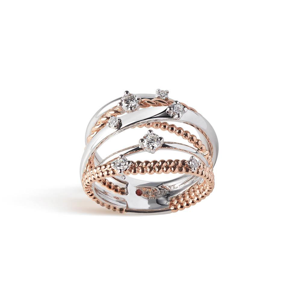 Intertwined bandring in 18 kt white and rose gold set with 0,35 ct for seven diamonds
