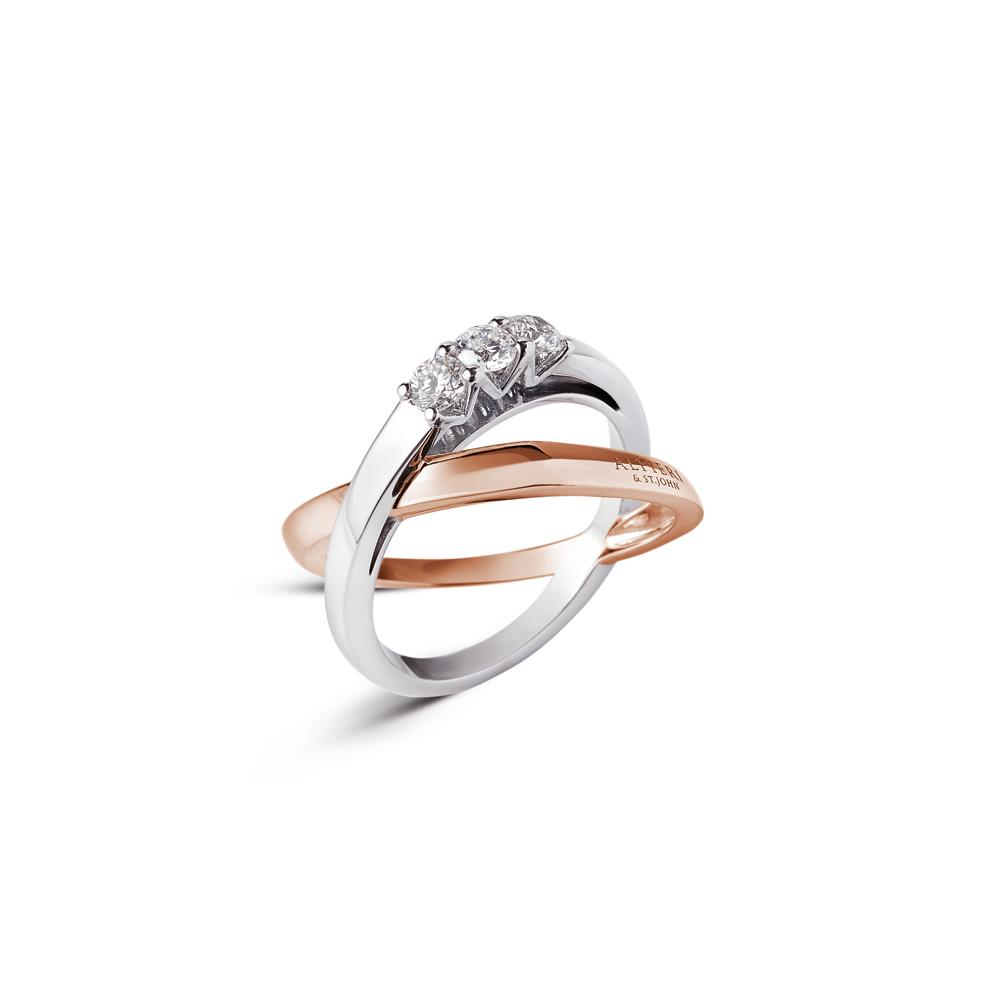 Intertwined ring in 18 kt white and rose gold set with 3 diamonds ct 0,21