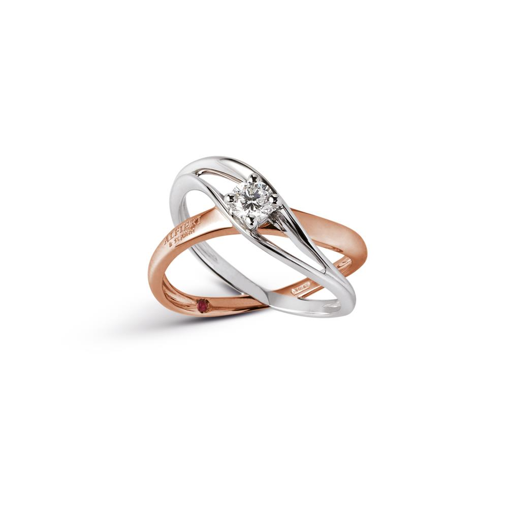 Intertwined ring in 18 kt white and rose gold with 0,15 ct diamond