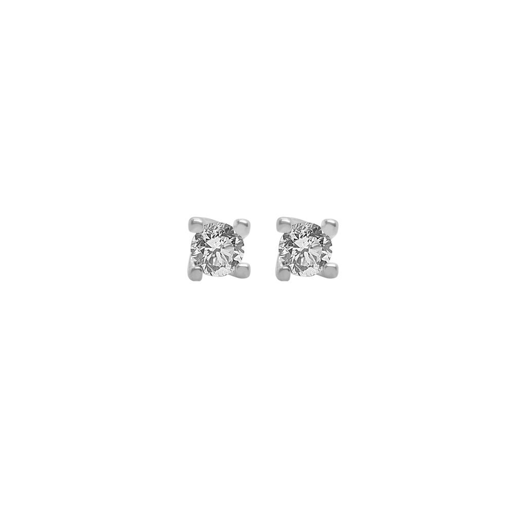 Four griffes diamond earrings set in white gold with ct 0.40