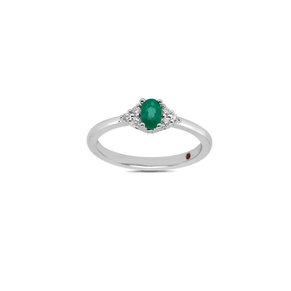 White gold ring with 0.11 ct diamonds and 0.45 ct oval cut emerald.