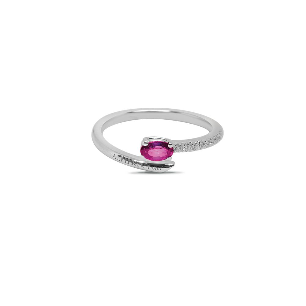White gold ring with 0.05 ct diamonds and 0.50 ct oval cut ruby. 