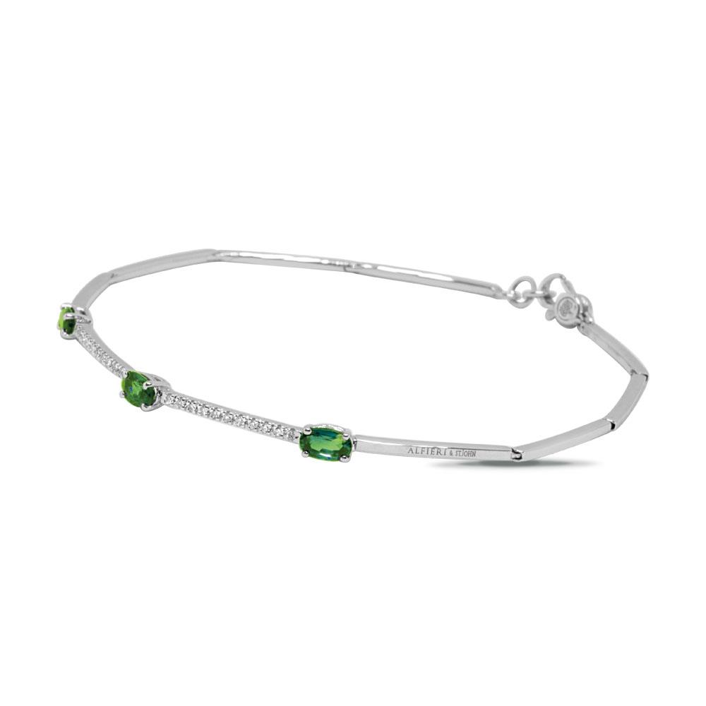 White gold bangle with 0.10 ct diamonds  and 0.75 ct oval cut emeralds