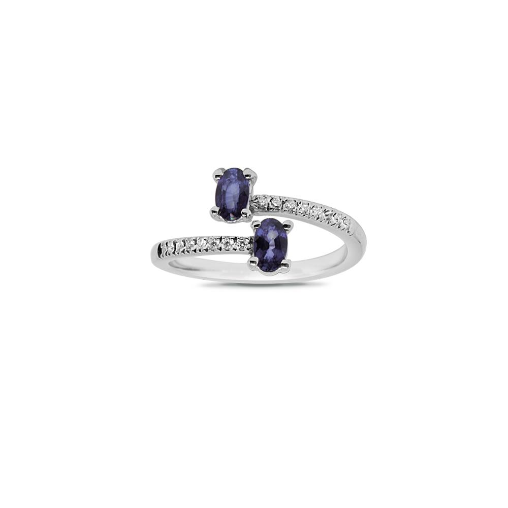 White gold ring with 0.17 ct diamonds and 1.80 ct oval cut sapphires. 
