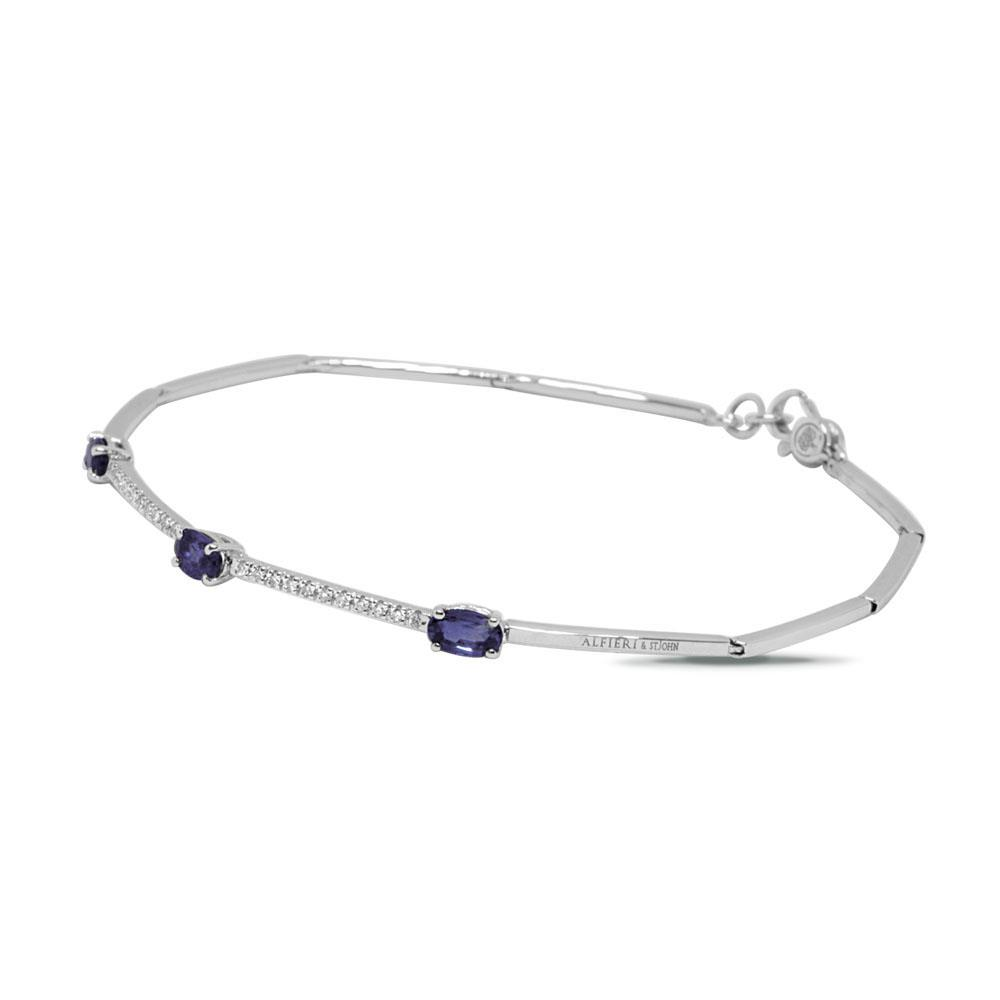White gold bangle with 0.10 ct  diamonds and 0.90 ct oval cut sapphires