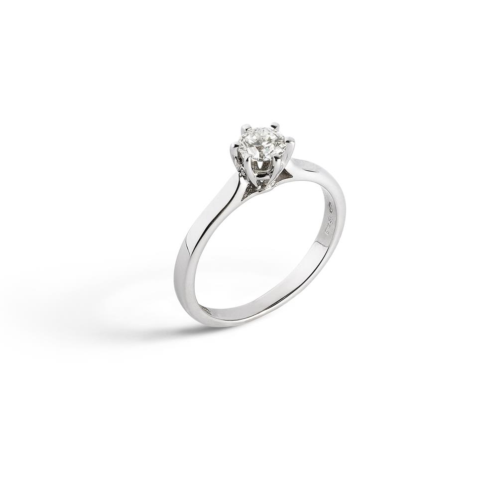 6 griffes solitaire ring set in 18 kt. with 0.80 ct diamond Available in different weighing in carats